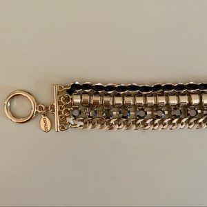 gold & black statement bracelet with fringe